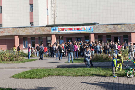 budgetary: SAINT-PETERSBURG, RUSSIA - CIRCA AUGUST, 2014: Crowd of people stand in queue to buy swimming season ticket for a kids. A small quantity of budgetary places for children in sports department. Editorial