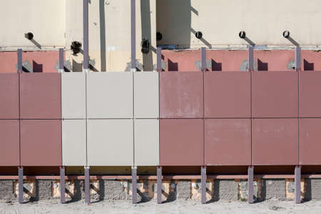 ventilated: Installation of ventilated facades with tiles of building wall Stock Photo