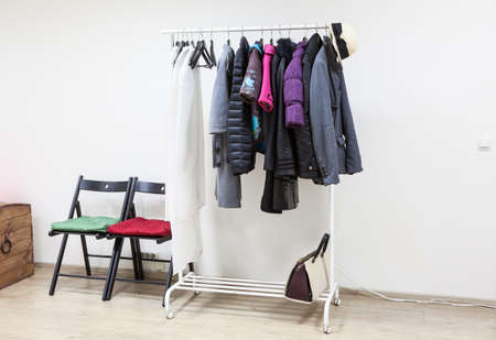 outerwear: Floor rack with outerwear in the interior hallway room, nobody
