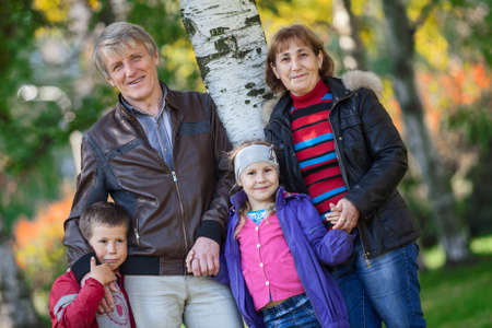 Happy smiling four people family portrait outdoors photo