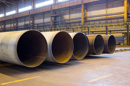 diameter: Large diameter pipes are stacked in an industrial factory shop