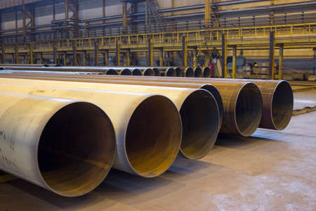 ferrous foundry: Large diameter pipes are in industrial workshop