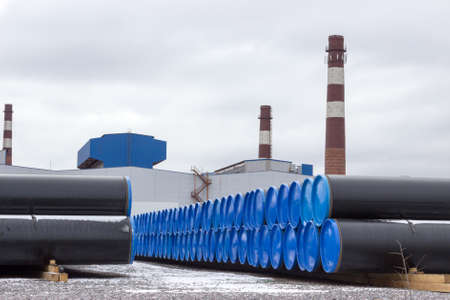 ferrous foundry: Rolling mill plant with open warehouse of steel big pipes ready for supply Stock Photo