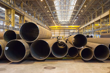ferrous foundry: Indoor storage with steel pipes, plant workshop