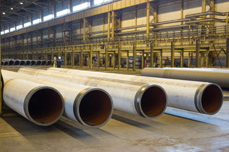 The gas supply pipes of large diameter are stacked in workshop