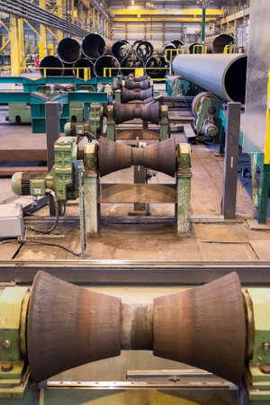 ferrous foundry: Tube-rollers manufacture line at the pipe rolling factory Editorial