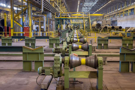 ferrous foundry: Pipes rolling line at pipeline manufacture, metallurgy industry