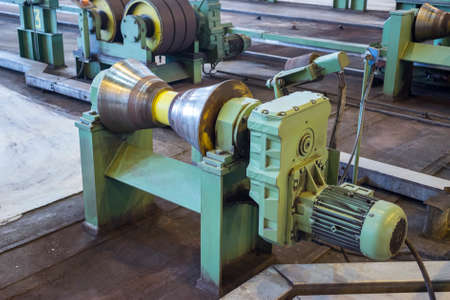 ferrous foundry: Close-up view of pipe rolling plant equipment, matallurgy industry Editorial