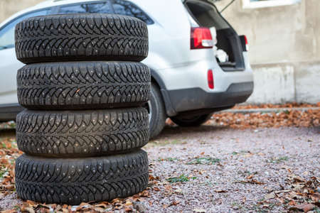 Four winter tyre wheels are near suv, copyspace photo