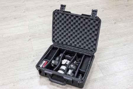 protector: Watertight protector plastic case with photo equipments inside Stock Photo