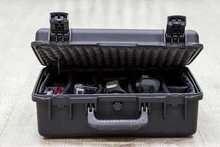 watertight: Bit open plastic case on floor with photo equipments in dividers