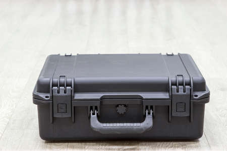 watertight: Closed plastic black protector case laying on the floor