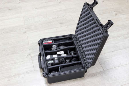 watertight: Protector plastic case with photo equipments inside is on the floor