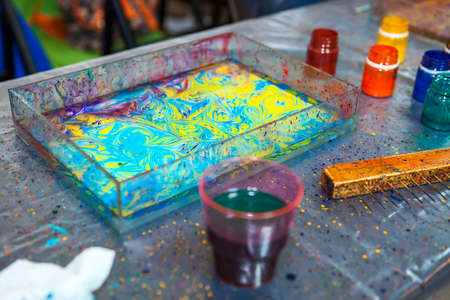 marbling: Items, paints and accessories for ebru water marbling are on the table Stock Photo