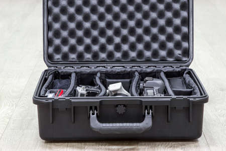 watertight: Opened plastic case with photo equipments in dividers Stock Photo