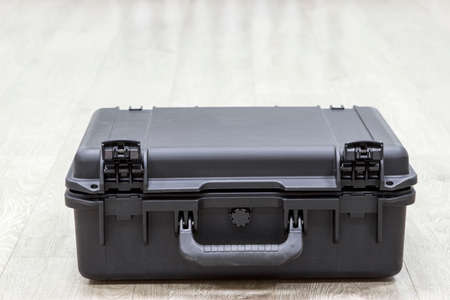 watertight: Closed plastic black watertight case on a floor