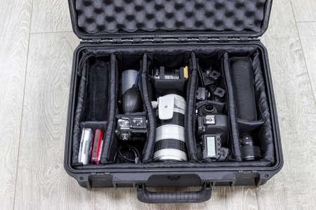 watertight: Photo equipments arranged inside of the black protector plastic case