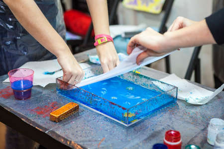 art lessons: Process of printing inks from water surface into silk, ebru marbling