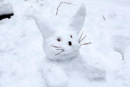 wintery day: Rabbit snowman making from snow at winter season Stock Photo