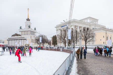 MOSCOW, RUSSIA - CIRCA JAN, 2015: Main city skating rink is in Moscow VDNKh area near central pavilion building. VDNKh is the all-Russian Exhibition Center with huge skating ring at winter season
