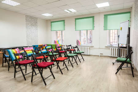 capes: Chairs with colored capes in the hall for seminar or meeting