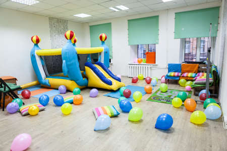 Interior of room with an inflatable trampoline for children birthday or party photo