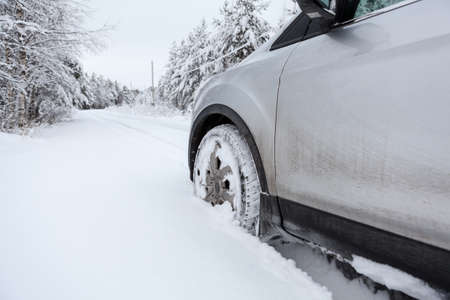 winter tire: Front wheel in winter tire in snowdrift Stock Photo