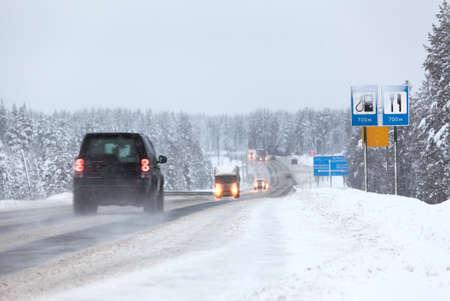 Vehicles driving on the Kola highway in winter season. The Kola is a federal road from St. Petersburg to Murmansk