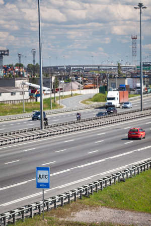 encircling: City encircling highway with driving vehicles, summer day. St. Petersburg, Russia Stock Photo