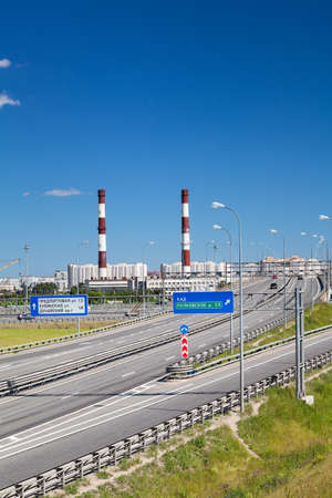 encircling: Encircling highway junction and direction sign with driving cars, summer day. St. Petersburg, Russia Stock Photo