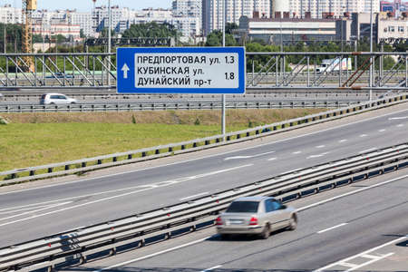 information superhighway: Car driving city encircling highway, St. Petersburg, Russia. Road direction marks