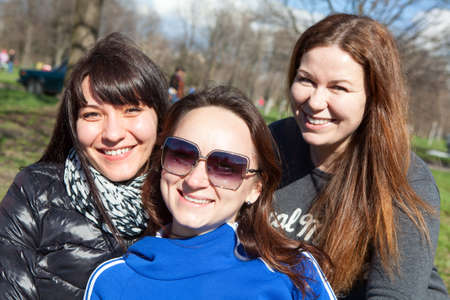 frendship: Three smiling Caucasian attractive women looking at camera