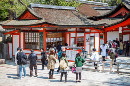 ticket office: MIYAJIMA, JAPAN - CIRCA APR, 2013: The entrance and ticket office of Itsukushima Shrine. Tourists buy tickets to visit the temples. Miyajima Island (Itsukushima), Japan