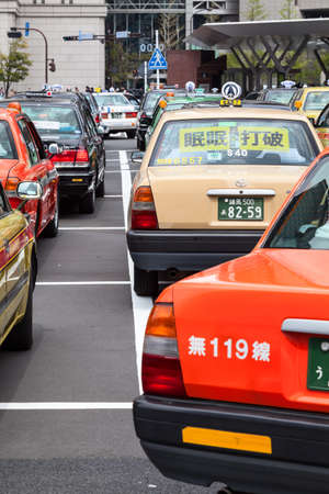 taxicabs: TOKYO, JAPAN - CIRCA APR, 2013: Color taxicabs wait passengers on the parking area near the Tokyo undeground station. Public transport is in center of the city