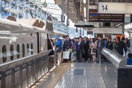 rail route: TOKYO, JAPAN - CIRCA APR, 2013: Queue for boarding the train-bullet (Shinkansen) to the Kyoto city is in the Tokyo rail station. Tokyo Station is a railway station in the Marunouchi district of Chiyoda