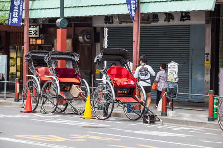 asakusa: TOKYO, JAPAN - CIRCA APR, 2013: Rickshaw stands on the road for tourists riding in the Asakusa district. Asakusa district with Sensoji shrine is famous place for people visiting Editorial