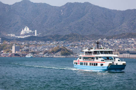 disembarking: MIYAJIMAGUCHI, JAPAN - CIRCA APR, 2013: Ferry of Matsudai Kisen company goes to the island of Miyajima (Itsukushima) from Miyajimaguchi ferry-port. The Hiroshima gulf, Japan