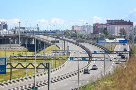 encircling: SAINT-PETERSBURG, RUSSIA - CIRCA JULY, 2014: Vehicles drive on exit to the Saint-Petersburg city encircling highway. The federal public ringroad around the city