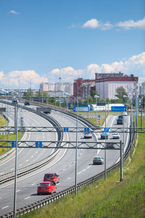 Exits and intercharges of St. Petersburg ring road at summer season. Russia Editorial