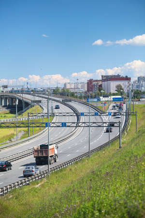 exits: Exits and intercharges of St. Petersburg ring road at summer season. Russia Editorial