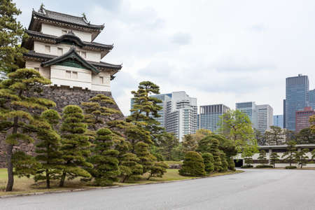 tokyo prefecture: View from the Tokyo Imperial Palace ground at the Fujimi-yagura three-story keep in park and city buildings. The Tokyo Imperial Palace, Japan Editorial