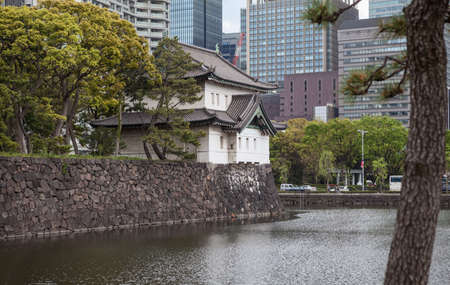tokyo prefecture: TOKYO, JAPAN - CIRCA APR, 2013: Edo Castle towers, wall and moat with high-rise modern buildings are in surroundings of the Tokyo Imperial Palace. The Tokyo Imperial Palace is the main residence of the Emperor of Japan Editorial