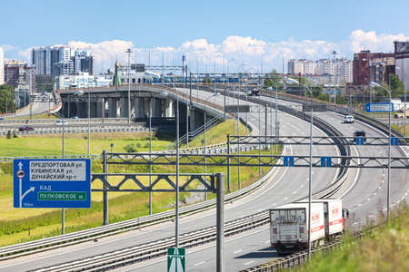 encircling: SAINT-PETERSBURG, RUSSIA - CIRCA JULY, 2014: Truck drives on exit to the Saint-Petersburg city encircling highway. The federal public ringroad around the city Editorial