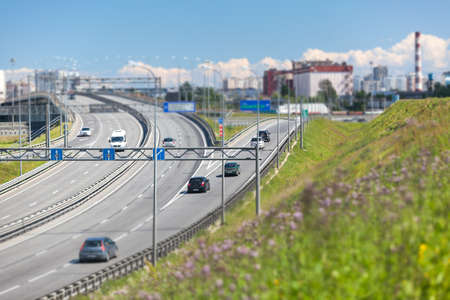 encircling: SAINTPETERSBURG RUSSIA CIRCA JULY 2014: Car drives on exit to the SaintPetersburg city encircling highway. The federal public ringroad around the city