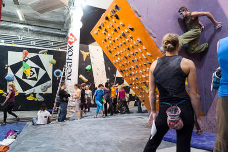 rockclimbing: SAINT-PETERSBURG, RUSSIA - CIRCA FEB, 2015: Rock-climbing championship is in IgelsClub. Sportsmen climb the walls. Igelsclub is a parkour park with climbing gym and trampolines