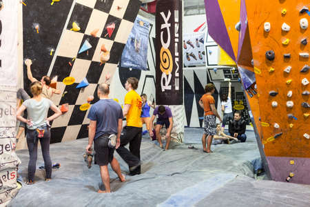 rockclimbing: SAINT-PETERSBURG, RUSSIA - CIRCA FEB, 2015: Climbers have rock-climbing workout in Igelsclub gym. Sportsmen climb the walls. Igelsclub is a parkour park with climbing gym and trampolines Editorial