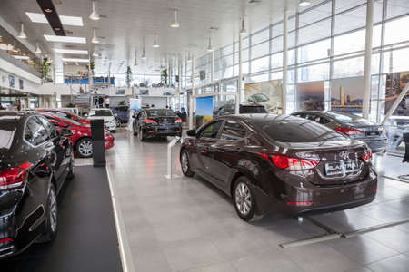 car showroom: ST. PETERSBURG, RUSSIA - CIRCA APR, 2015: Hyundai Elantra car stands in auto dealership showroom. The Rolf Lahta is a official dealer of Hyundai