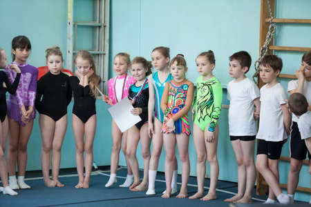 russian: ST. PETERSBURG, RUSSIA - CIRCA APR, 2014: Girls are winners of aerobics. Kids stand with medals and certificates. Russian children competitions