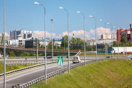 encircling: SAINT-PETERSBURG, RUSSIA - CIRCA JULY, 2014: Car drives on exit to the Saint-Petersburg city encircling highway. The federal public ringroad around the city