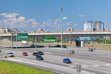 encircling: SAINTPETERSBURG RUSSIA CIRCA JULY 2014: Cars are on multilane city encircling highway. The federal public ringroad is around the city